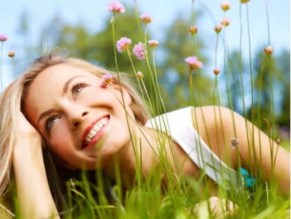 healthy-woman-grass-flowers
